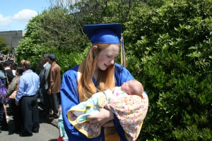 The graduate holding her baby sister