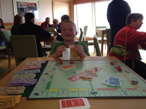Proud winner of his first game of Monopoly